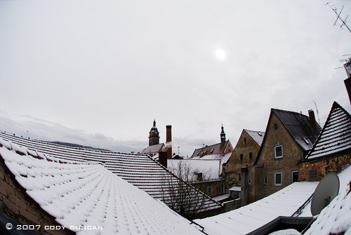 Snow covered rooftops and cloudy skies in small german town. Cody Duncan Photography