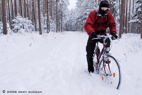 © cody duncan photography. Riding bicycle in snow, germany