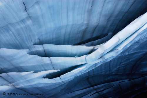 © cody duncan photography.  ceiling of glacier ice cave, Bernese alps, Switzerland