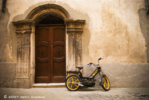 moped and old doorway in Sospel, Cote d'azur, France.  Cody Duncan Photography