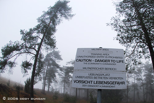 © Cody Duncan photography.  warning sign at border of American army base in Germany