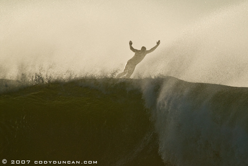 surfer bailing from large wave, Rincon