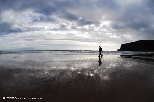 © Cody Duncan Photography.  silhouette of person walking on beach at Rackwick bay, Hoy, Orkney, Scotland