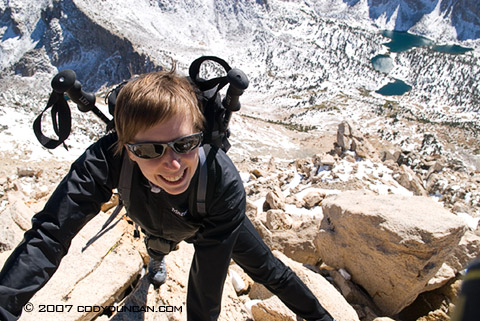 Cody Duncan stock photography: Female mountaineer climbing in Sierra Nevada Mountains, California.  © Cody Duncan Photography