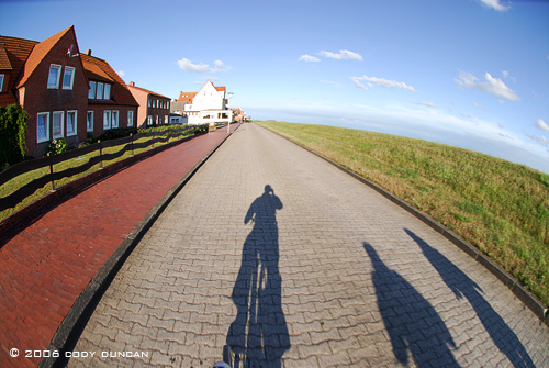 Shadows of people riding bicycles on island of Juist, Germany.  © Cody Duncan Photography