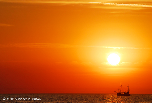 Fishing boat in North sea at sunset, Juist, Germany.  © Cody Duncan Photography