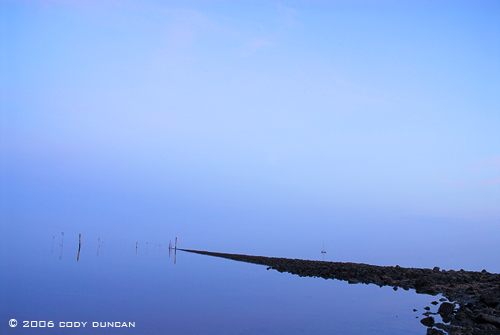 Reflection in wadden sea, wattenmeer, harbor during lowtide, Juist, Germany. © Cody Duncan Photography