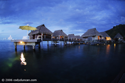 Luxury hotel rooms over water at Moorea Pearl hotel, Moorea, French Polynesia. © Cody Duncan Photography