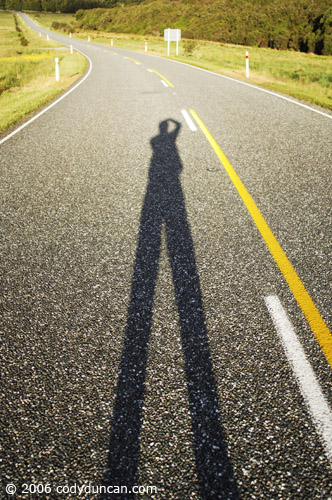 shadow self portrait on empty road in New Zealand.  © Cody Duncan Photography