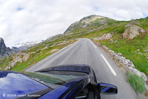 Car driving through Norwegian mountains. © Cody Duncan Photography