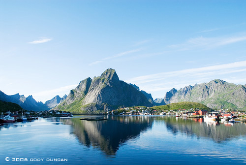 reflection of mountains and village of Reine in lofoten Islands, Norway.  © Cody Duncan Photography