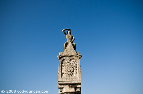 German travel photo: statue of watchman on stone bridge over Danube, Regensburg, Germany. © Cody Duncan Photography