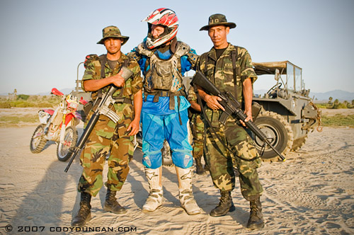 Motorcycle rider and Mexican army soldiers in Baja California, Mexico. © Cody Duncan Photography