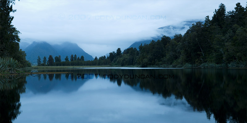 New Zealand Stock landscape Photo: reflection in Lake Matheson, New Zealand.  © Cody Duncan photography