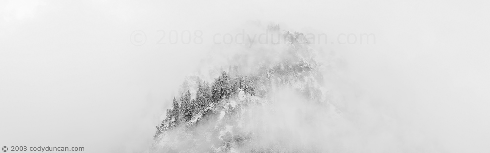 Cody Duncan Stock Photography: Panoramic landscape photo of Snow covered mountain and clearing clouds. © Cody Duncan Photography