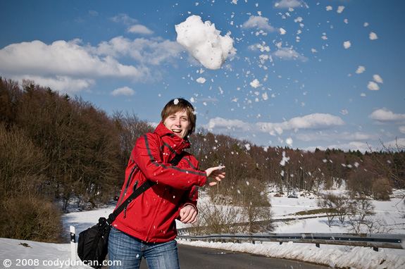 Cody Duncan Stock Photography: female throwing snowball, Germany. © Cody Duncan Photography