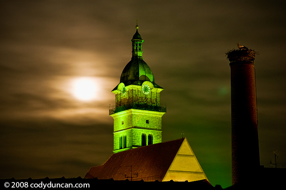 Full moon and Church at night, Bavaria, Germany. Cody Duncan travel stock photography