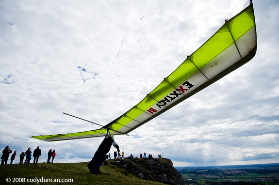 Hang glider taking flight, Walberla, Germany. Cody Duncan travel stock photography