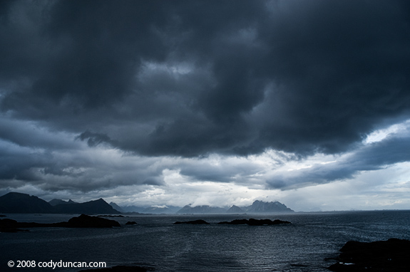 Stormy sky over mountains of Lofoten islands, Norway. Cody Duncan stock photography