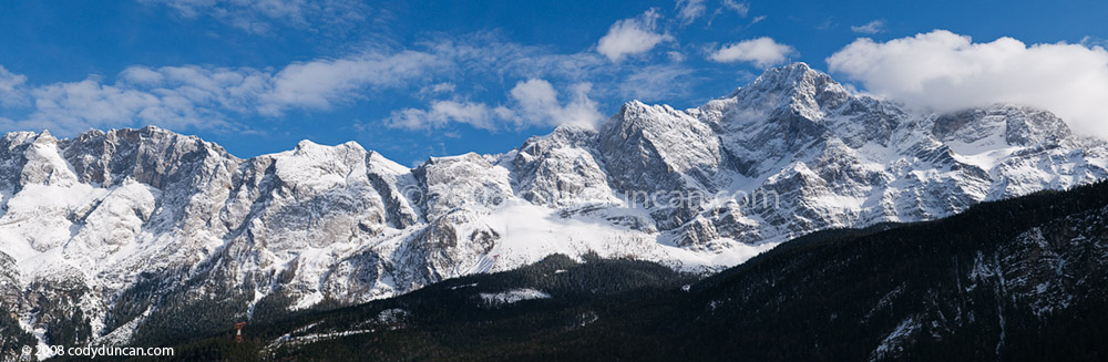 Panoramic stock photography; Zugspitze with winter snow, Germany. Cody Duncan travel photography