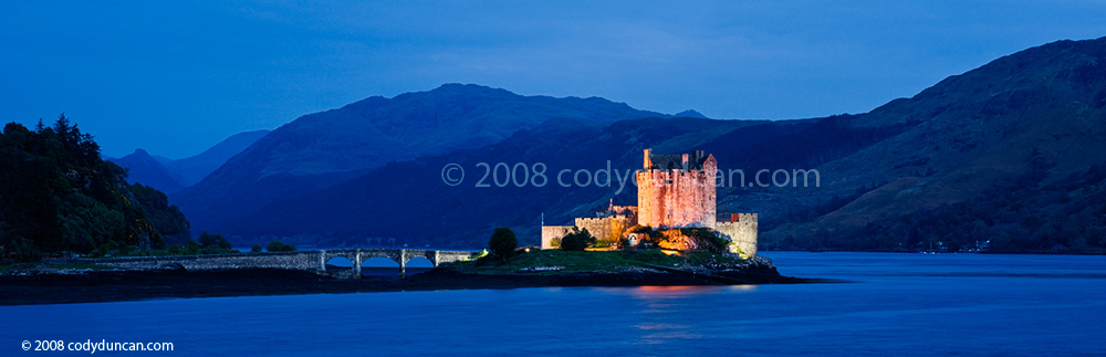 Scotland Stock Photo: Eilean Donan castle at dusk panoramic. © Cody Duncan photography
