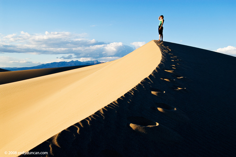 Female walking along sand dune, Death Valley national park, California
