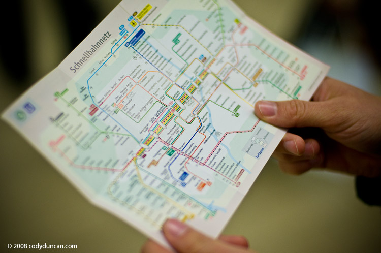 German travel stock photo: Hands holding Munich subway map. Cody Duncan photography