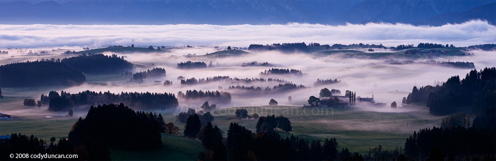 Panoramic stock images: Autumn mist at dawn in the Allgaeu region of Bavaria, Germany. Cody Duncan travel photography
