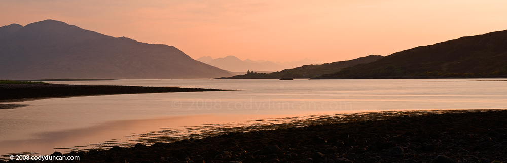 Panoramic stock photo: Evening light on Loch Duich with mountains of Isle of Skye in far distance, Scotland. Cody Duncan Photography