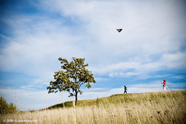 Cody Duncan travel photography: Mother and son fly kite on Walberla Hill, Franconia, Germany