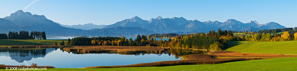 Germany stock travel photography: panoramic photo of Forggensee and Allgaeu mountains in autumn
