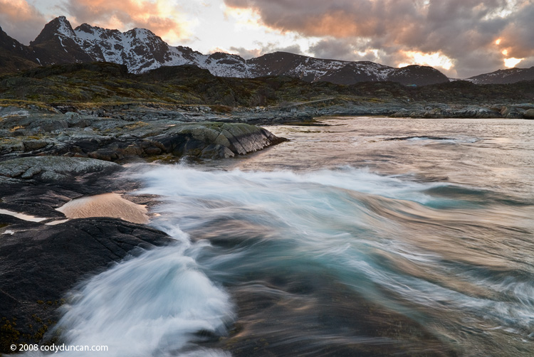 Lofoten Stock photography: Stormy waves crashing against rocks, Stamsund, Lofoten islands, Norway. Cody Duncan Photography