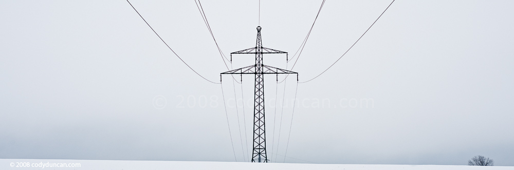 Panoramic stock photo: Germany, Oberpfalz; electrical power lines across barren winter landscape. Cody Duncan Photography