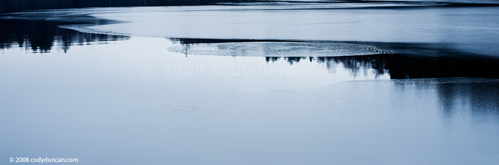 Panoramic stock photo: Germany, Oberpfalz; partially frozen pond in early winter. Cody Duncan Photography