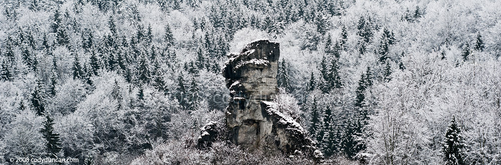 German travel stock photo: forest and limestone rock formation in Franconian Switzerland, winter panoramic photo. Cody Duncan photography