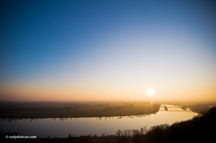 Winter sun sets over Danube river as seen from Walhalla temple, Regensburg, Oberpfalz, Bavaria, Germany. Cody Duncan travel photography