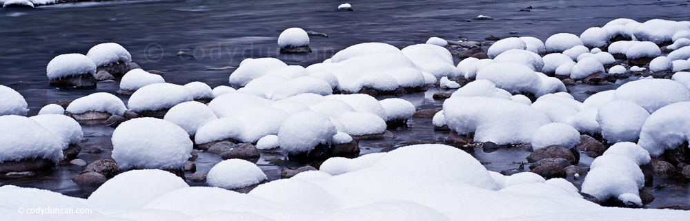 Germany travel stock panoramic photo: Snow covered rocks along river, Berchtesgaden, Bavaria