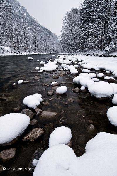 Germany travel stock photo: Snow covered rocks along river, Berchtesgaden, Bavaria