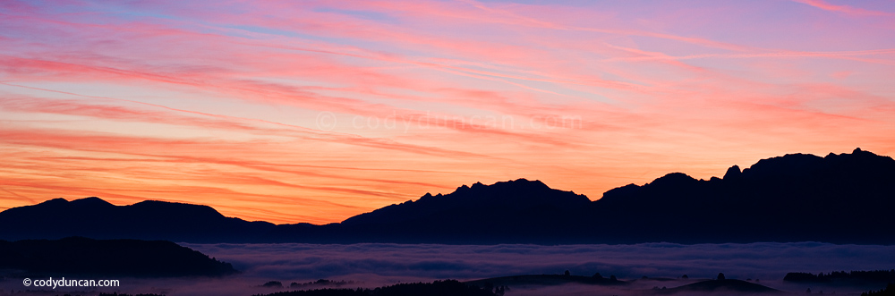 Germany panoramic stock photo: Sunrise over AllgaeŠu alps with valley fog, near Fuessen, Bavaria, Germany