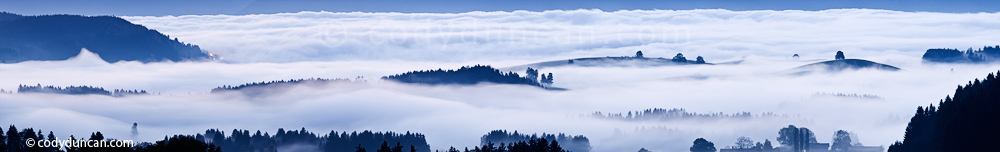 Germany panoramic stock photo: hills rise above morning fog, Allgaeu region, Bavaria, Germany