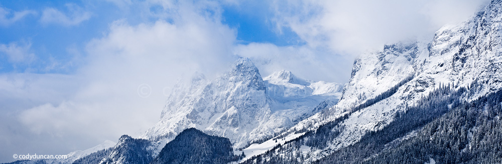German panoramic stock photo: winter storm clears over mountains of Berchtesgaden national park, Bavaria, Germany