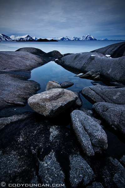 photo of rocky coastline and mountains, Stamsund, Lofoten islands, Norway