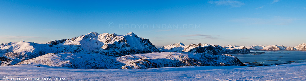 Lofoten islands winter panoramic photo: Justadtind mountain peak at sunset