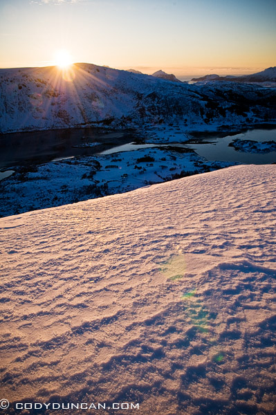 Lofoten islands winter mountain photo: sun setting over mountains, Stamsund, Lofoten islands, Norway