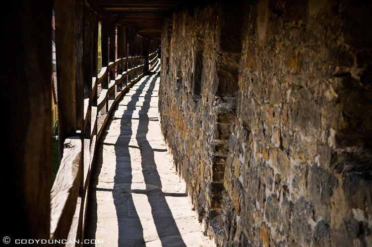 Walkway along historic stone wall, Rothenburg ob der Tauber, Franconia, Bavaria, Germany