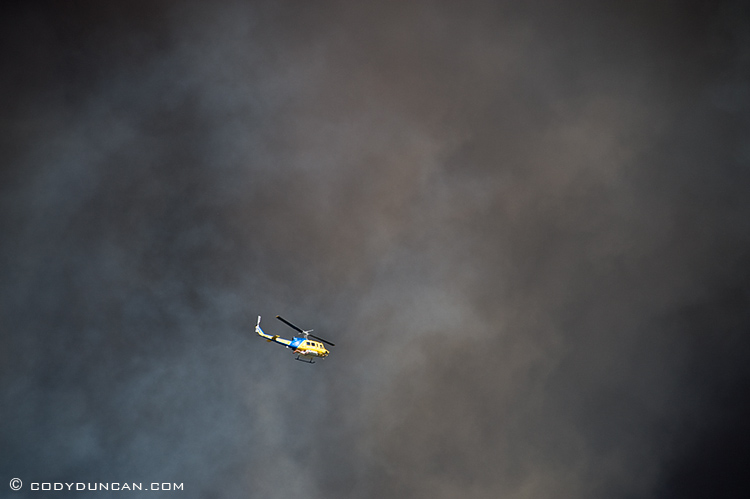 jesusita fire santa barbara, California: helicopter flies against sky black with smoke