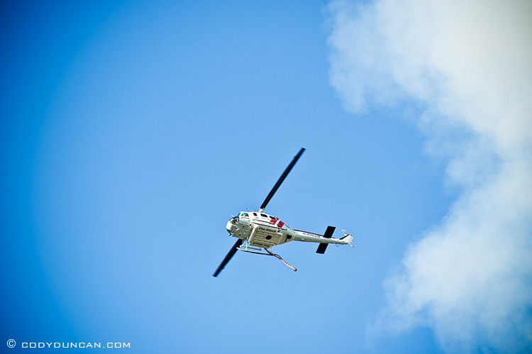 Fire fighting helicopter flying in sky above santa barbara, CA