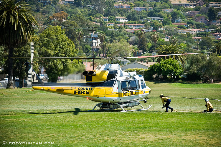 LA county fire helicopter filling with water at Santa Barbara Jr. High School during Jesusita fire, May 6 2009