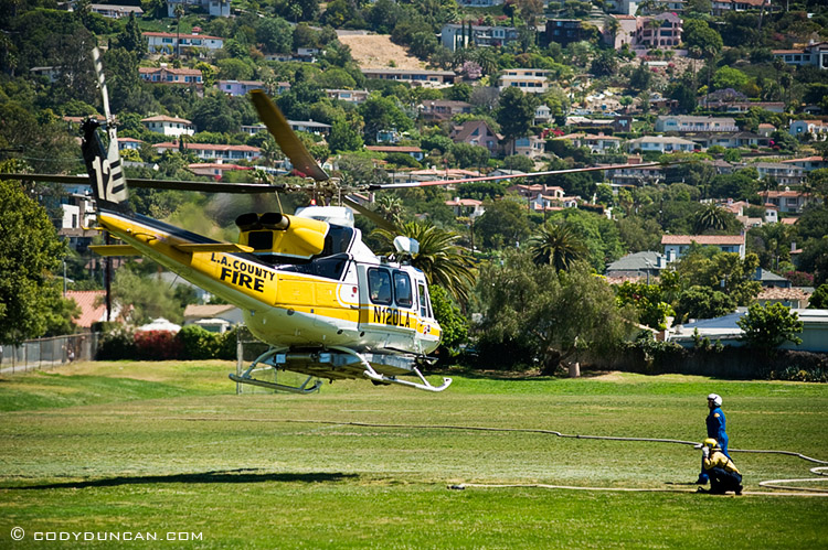 LA county fire helicopter lifting off from Santa Barbara Jr. High School during Jesusita fire, May 6 2009