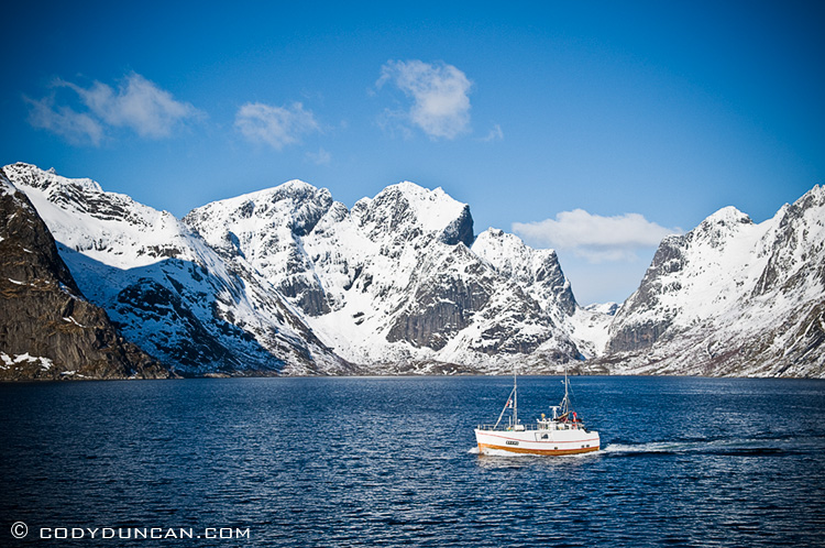 Fishing boat in Kjerkefjord near Reine, Lofoten Islands, Norway